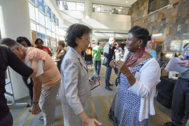 Showcase sponsor Shuk-mei Ho, Ph.D., (left) vice chancellor for research, chats with Pebbles Fagan, Ph.D.