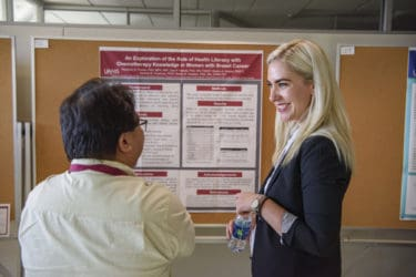 Pearman Parker, Ph.D., M.P.H., presents her poster on the role of health literacy with chemotherapy knowledge in women with breast cancer.