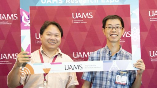 "Yuet-Kin ""Ricky"" Leung, Ph.D. (left), won the 2020 Research Expo's Grand Door Prize, a manuscript submission fee to be paid by TRI. Leung also enjoyed the 2019 Expo, above with Nagai C. ""Neville"" Tam, Ph.D. (File Photo)"
